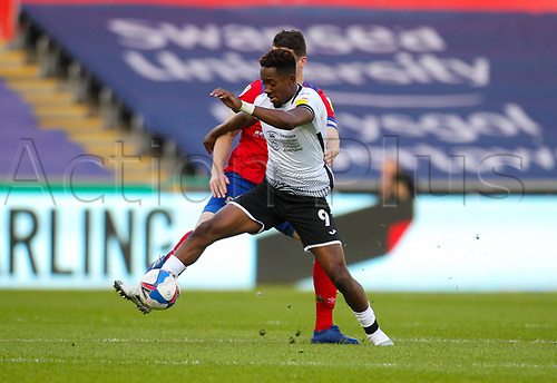 31st October 2020; Liberty Stadium, Swansea, Glamorgan, Wales; English Football League Championship Football, Swansea City versus Blackburn Rovers; Jamal Lowe of Swansea City controls the ball while under pressure from Darragh Lenihan of Blackburn Rovers