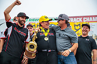 Aug 19, 2018; Brainerd, MN, USA; NHRA top fuel driver Billy Torrence (center) celebrates with son Steve Torrence (right) and crew members after winning the Lucas Oil Nationals at Brainerd International Raceway. Mandatory Credit: Mark J. Rebilas-USA TODAY Sports