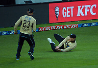NZ's Martin Guptill catches Joshua Philippe during the third international men's T20 cricket match between the New Zealand Black Caps and Australia at Sky Stadium in Wellington, New Zealand on Wednesday, 3 March 2021. Photo: Dave Lintott / lintottphoto.co.nz