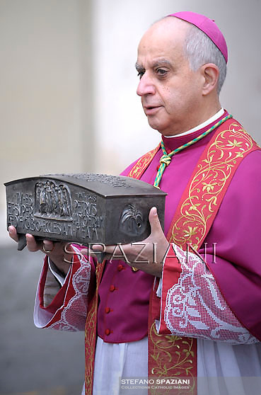 Monsignor Rino Fisichella,Pope Francis holds the relics of St. Peter while celebrating the Holy Mass on the occasion of the closing of the Year of Faith, in the Vatican, 24 November 2013.