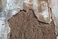 Peru, Cusco.  Falling Plaster Reveals Mud-brick Construction of Houses in Old Residential Areas above the Plaza de Armas.