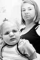 Makayla Read with her mom Kelly at the Share and Care Network's annual retreat held at the Doubletree Guest Suites Hotel in Boston on May 20, 2006. <br /> <br /> The Share and Care Network was created in 1981 by Pat Cahill when her son Scott was diagnosed with Cockayne Syndrome.  A rare form of dwarfism, Cockayne Syndrome is a genetically determined condition whose symptoms include microcephaly, mental retardation, progressive blindness, progressive hearing loss, premature aging, and a shortened lifespan averaging 18 years.  Those afflicted have distinctive facial features, including sunken eyes, pinched faces, and protruding jaws as well as distinctive gregarious, affectionate personalities.<br /> <br /> Because of the rarity of the condition (1/1,000 live births) and its late onset (characteristics usually begin to appear only after one year), many families and physicians are often baffled by children whose health begins to deteriorate after normal development.  It was partly with this in mind that the Share and Care Network was formed, to promote awareness of this disease as well as to provide a support network for those families affected.  In 1998 it began organizing an annual retreat, which has grown from three families in its inaugural year to more than 30 today.  Although the retreat takes place in the United States, families from as far as Japan arrive for this one weekend out of the year to share information and to support one another.