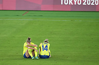 YOKOHAMA, JAPAN - AUGUST 6: Sweden players including Nathalie Bjorn #14 react to lossing during a game between Canada and Sweden at International Stadium Yokohama on August 6, 2021 in Yokohama, Japan.
