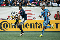 FOXBOROUGH, MA - SEPTEMBER 29: Teal Bunbury #10 of New England Revolution controls the ball as Alexander Callens #6 of New York City FC comes in to tackle during a game between New York City FC and New England Revolution at Gillettes Stadium on September 29, 2019 in Foxborough, Massachusetts.
