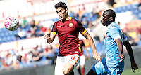 Calcio, Serie A: Roma vs Napoli. Roma, stadio Olimpico, 25 aprile 2016.<br /> Roma's Diego Perotti, left, and Napoli's Kalidou Koulibaly fight for the ball during the Italian Serie A football match between Roma and Napoli at Rome's Olympic stadium, 25 April 2016. <br /> UPDATE IMAGES PRESS/Isabella Bonotto