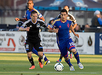 Martin Rivero of Rapids dribbles the ball away from Sam Cronin of Earthquakes during the game at Buck Shaw Stadium in Santa Clara, California on May 18th, 2013.  San Jose Earthquakes tied Colorado Rapids, 1-1.