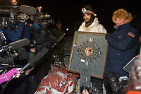 Lance Mackey receives the *Spirit of Iditarod* award for being the first musher to reach the McGrath checkpoint from Penair's President, Danny Seybert, on Tuesday evening during Iditarod 2008