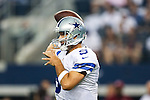 Dallas Cowboys quarterback Tony Romo (9) in action during the pre-season game between the Baltimore Ravens and the Dallas Cowboys at the AT & T stadium in Arlington, Texas. The Ravens lead Dallas 24 to 10 at half time.