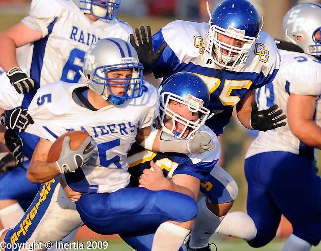 SIOUX FALLS, SD - SEPTEMBER 18:   Seth Johnson of Rapid City Stevens is stopped at the line by Austin Berg #79 and Austin Whaley #75 of O'Gorman. The Knights defeated the Raiders 13-6 at McEneaney Field in Sioux Falls. (Photo by Craig Johnson/Inertia)