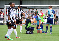 Dan Rowe of Wycombe Wanderers gets attention from the trainer during the Friendly match between Maidenhead United and Wycombe Wanderers at York Road, Maidenhead, England on 30 July 2016. Photo by Alan  Stanford PRiME Media Images.