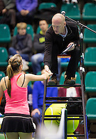 14-12-12, Rotterdam, Tennis Masters 2012, Quirine Lemoine  shekes hands with the umpire after her match against Angelique van der Meet