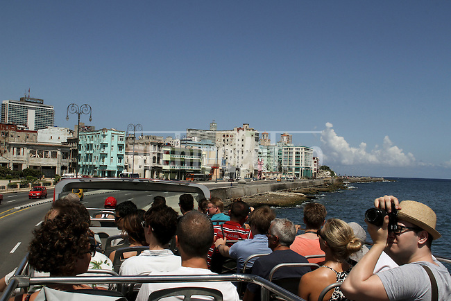 Tourists sighseeing at El Malecon in old Havana