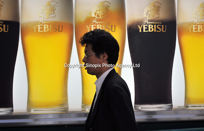 An advert for the popular Japanese brewed Yebisu beer in downtown Tokyo, Japan. Yebisu is brewed by the Sapporo brewery origin in Sapporo, Hokkaido during the Meiji period..09 Sep 2008.