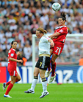 Melanie Behringer (l) of Germany and Rhian Wilkinson of Canada during the FIFA Women's World Cup at the FIFA Stadium in Berlin, Germany on June 26th, 2011.