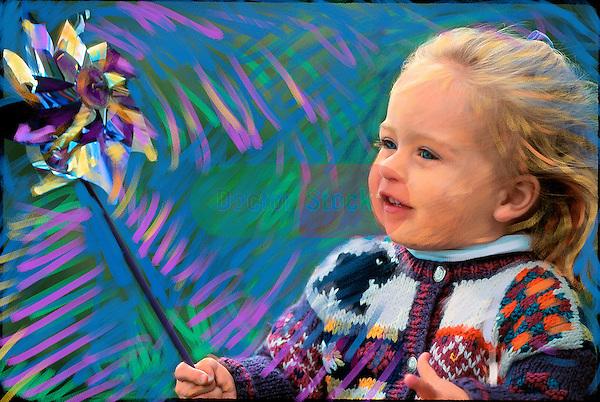 young girl playing with pinwheel