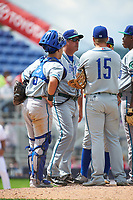 Hartford Yard Goats pitching coach Dave Burba (36) talks with starting pitcher Yency Almonte (right) as catcher Dom Nunez (9) and first baseman Brian Mundell (15) listen in during a game against the Binghamton Rumble Ponies on July 9, 2017 at NYSEG Stadium in Binghamton, New York.  Hartford defeated Binghamton 7-3.  (Mike Janes/Four Seam Images)