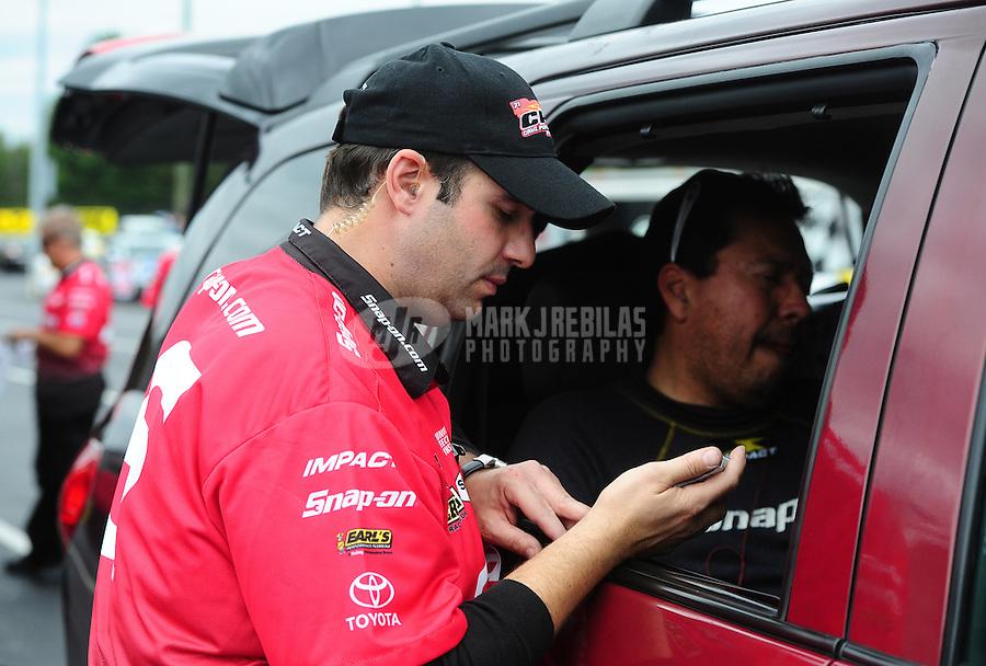 Sept. 18, 2011; Concord, NC, USA: NHRA crew member for funny car driver Cruz Pedregon during the O'Reilly Auto Parts Nationals at zMax Dragway. Mandatory Credit: Mark J. Rebilas-