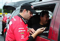 Sept. 18, 2011; Concord, NC, USA: NHRA crew member for funny car driver Cruz Pedregon during the O'Reilly Auto Parts Nationals at zMax Dragway. Mandatory Credit: Mark J. Rebilas-