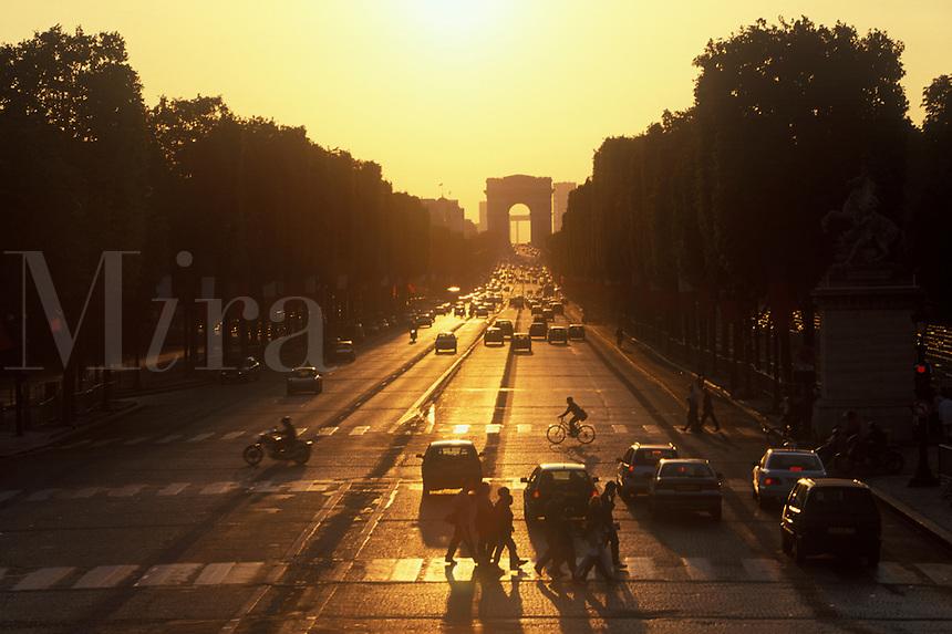 The Avenue des Champs-Elys¬?es, Paris, at dusk with Arc de Triomphe in the distance.