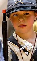 A young boy learns about the Civil War during a hands-on history lesson offered by Latta Plantation in Huntersville, near Charlotte, NC.