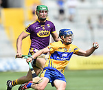 Podge Collins of Clare in action against Matthew O Hanlon of Wexford during their All-Ireland quarter final at Pairc Ui Chaoimh. Photograph by John Kelly.