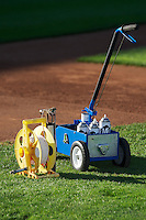 A spool of string and the paint cart sit ready for the grounds crew to mark the field when the Ogden Raptors faced the Orem Owlz in Pioneer League play at Lindquist Field on August 28, 2013 in Ogden Utah.  (Stephen Smith/Four Seam Images)