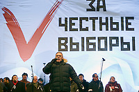"Moscow, Russia, 24/12/2011..Opposition politician and former Prime Minister Mikhail Kasyanov speaks to an estimated crowd of up to 100,000 gathered to protest against election fraud and Prime Minister Vladimir Putin in the largest anti-government demonstration in Russia since the collapse of the Soviet Union. The banner behind reads ""For Honest Elections""."