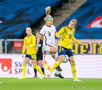 SOLNA, SWEDEN - APRIL 10: Julie Ertz #8 of the USWNT dights for the ball with Filippa Angeldal #19 of Sweden during a game between Sweden and USWNT at Friends Arena on April 10, 2021 in Solna, Sweden.
