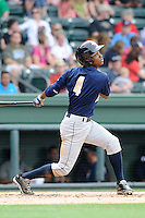 Second baseman Claudio Custodio (4) of the Charleston RiverDogs bats in a game against the Greenville Drive on Sunday, May 19, 2013, at Fluor Field at the West End in Greenville, South Carolina. Charleston won, 9-7. (Tom Priddy/Four Seam Images)