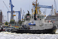 Cargo boat (ship) with cranes in Elbe near docks of Hamburg port