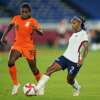 YOKOHAMA, JAPAN - JULY 30: Crystal Dunn #2 of the United States and Lineth Beerensteyn #18 of the Netherlands battle for the ball during a game between Netherlands and USWNT at International Stadium Yokohama on July 30, 2021 in Yokohama, Japan.