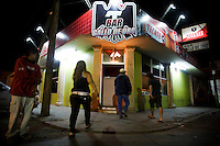 """Entrance of a bar in the red zone area -""""EL Bajio"""".<br /> <br /> Northern Mexico is very polarized in sense of social status. In the red zone of Ensenada - """"El Bajio"""", people of considered """"low-class"""" have their share of night life. Alcoholics, prostitutes, drug junkies and the simple survivors find cheap beer and  entertainment.."""