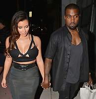 MIAMI BEACH, FL - OCTOBER 14: Kim Kardashian and boyfriend Kanye West enjoyed a quite romantic dinner in a South Beach restaurant on October 14, 2012 in Miami Beach, Florida. <br /> CAP/MPI122<br /> ©MPI122/Capital Pictures
