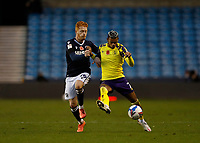 31st October 2020; The Den, Bermondsey, London, England; English Championship Football, Millwall Football Club versus Huddersfield Town; Ryan Woods of Millwall challenges Juniho Bacuna of Huddersfield Town
