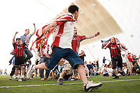 USA fans celebrate a second half goal that was called back moments later. The Red Bulls hosted a FIFA World Cup viewing party for the USA v Italy match at the Giants Stadium practice bubble, East Rutherford, NJ, June 17, 2006.