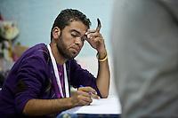 23 ottobre 2011 Tunisi, elezioni libere per l'Assemblea Costituente, le prime della Primavera araba: un Osservatore Nazionale in un seggio. Ha il dito macchiato di inchiostro indelebile, segno che ha votato.<br /> premieres elections libres en Tunisie octobre <br /> tunisian elections