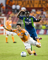 Houston Dynamo forward Brian Ching (25) goes down after colliding with Seattle Sounders defender Jhon Kennedy Hurtado (34).  Houston Dynamo tied Seattle Sounders 1-1 on August 23, 2009 at Robertson Stadium in Houston, TX.