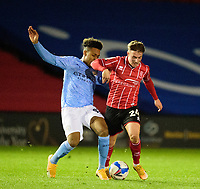 Lincoln City's Robbie Gotts battles with Manchester City U21's Micah Hamilton<br /> <br /> Photographer Andrew Vaughan/CameraSport<br /> <br /> EFL Papa John's Trophy - Northern Section - Group E - Lincoln City v Manchester City U21 - Tuesday 17th November 2020 - LNER Stadium - Lincoln<br />  <br /> World Copyright © 2020 CameraSport. All rights reserved. 43 Linden Ave. Countesthorpe. Leicester. England. LE8 5PG - Tel: +44 (0) 116 277 4147 - admin@camerasport.com - www.camerasport.com
