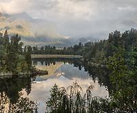 Lake Matheson sunset reflections, Westland Tai Poutini National Park, UNESCO World Heritage Area, West Coast, New Zealand, NZ