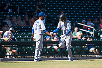 Surprise Saguaros designated hitter Cavan Biggio (26) is congratulated by third base coach Andy Fermin (2), both of the Toronto Blue Jays organization, after hitting a home run during an Arizona Fall League game against the Mesa Solar Sox at Sloan Park on November 1, 2018 in Mesa, Arizona. Surprise defeated Mesa 5-4 . (Zachary Lucy/Four Seam Images)
