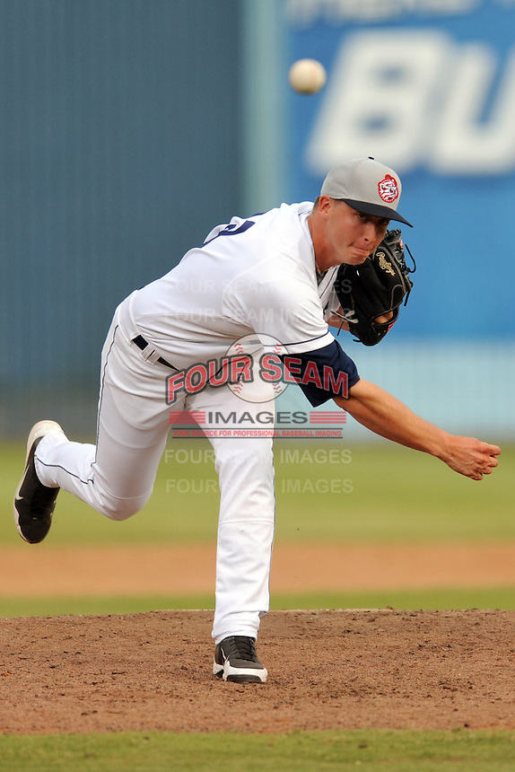 Asheville Tourists pitcher Andrew Brown #33 delivers a pitch during game one of a double header against the Greensboro Grasshoppers. on July 2, 2013 in Asheville, North Carolina.  The Tourists won the game 5-3. (Tony Farlow/Four Seam Images)