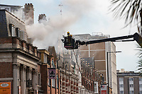 BNPS.co.uk (01202) 558833. <br /> Pic: CorinMesser/BNPS<br /> <br /> Fire fighters attend the scene of a serious blaze in Bournemouth town centre this afternoon. <br /> <br /> The fire, which appeared to start in a third floor flat, spread through the roof of the building engulfing much of the town in smoke.
