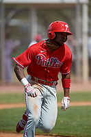 Philadelphia Phillies Kendall Simmons (21) runs to first base during an exhibition game against the Canada Junior National Team on March 11, 2020 at Baseball City in St. Petersburg, Florida.  (Mike Janes/Four Seam Images)