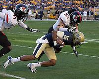Gardner-Webb linebacker Tanner Burch (55) tackles Pitt wide receiver Devin Street (15). The Pitt Panthers defeated the Gardner-Webb Runnin Bulldogs 55-10 at Heinz Field, Pittsburgh PA on September 22, 2012..