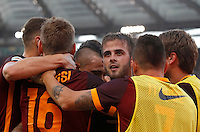 Calcio, Serie A: Roma vs Juventus. Roma, stadio Olimpico, 30 agosto 2015.<br /> Roma's Miralem Pjanic, third from right, celebrates with teammates after scoring during the Italian Serie A football match between Roma and Juventus at Rome's Olympic stadium, 30 August 2015.<br /> UPDATE IMAGES PRESS/Riccardo De Luca