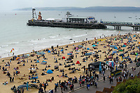 BNPS.co.uk (01202 558833)<br /> Pic: Graham Hunt/BNPS<br /> Date: 2nd September 2021.<br /> <br /> The beach is busy with spectators on day 1 of Bournemouth Air Festival in Dorset on a warm overcast day.