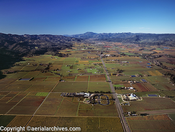 aerial photograph of the Napa Valley in fall along highway 29 from the Robert Mondavi Winery in Oakville, California towards Calistoga, Mount St. Helena is in the background.