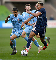 6th June 2021; AAMI Park, Melbourne, Victoria, Australia; A League Football, Melbourne Victory versus Melbourne City; Nuno Reis of Melbourne City attempts to intercept the ball  from Ben Folami of the Victory
