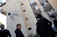Children visit a site where an apartment building was hit by a Palestinian rocket from the Gaza Strip, killing 58 year old Beber Vaknin, in the southern Israeli town of Netivot. Israeli forces began an air offensive against Hamas in Gaza on 27/12/2008, which quickly escalated into an offensive by land, sea and air, in retaliation against Palestinian rockets fired into Israel. After eight days of bombardment, leaving over 400 Palestinians and four Israelis dead, Israeli tanks entered Gaza on 04/01/2009...