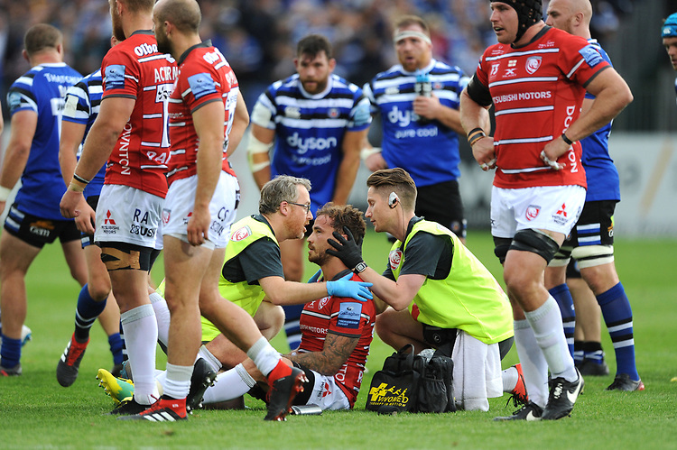 Players watch as Danny Cipriani of Gloucester Rugby is injured during the Gallagher Premiership Rugby match between Bath Rugby and Gloucester Rugby at The Recreation Ground on Saturday 8th September 2018 (Photo by Rob Munro/Stewart Communications)